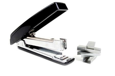 new black stapler on a white background photo