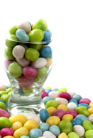 candy in a glass on a white background photo