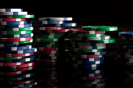 many poker chips on a black background