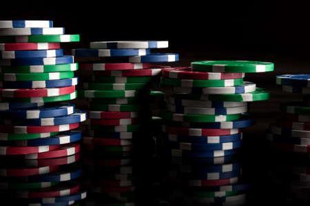 many poker chips on a black background