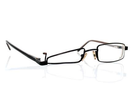 wrecked: broken black eyeglasses isolated on a white background
