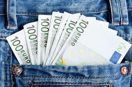 euro money in blue jeans pocket background photo