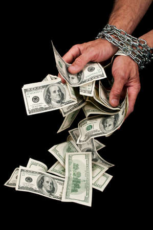 Hands with dollars in chain on a black background Stock Photo - 9856956