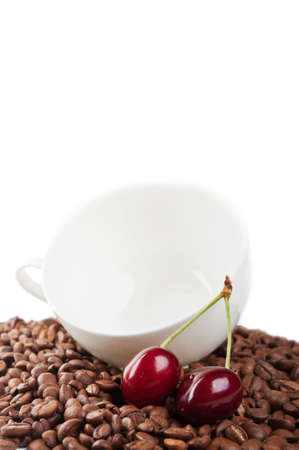 winnower: cup with coffee beans and cherry isolated on a white background