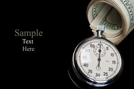 dollars and stopwatch isolated on a black background photo