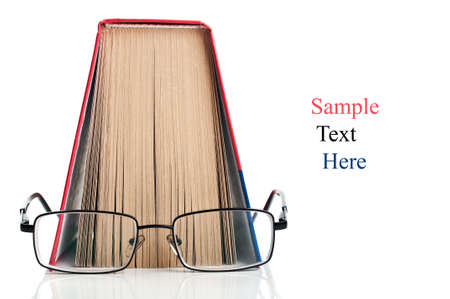 open book and glasses isolated on a white background Stock Photo - 10021438