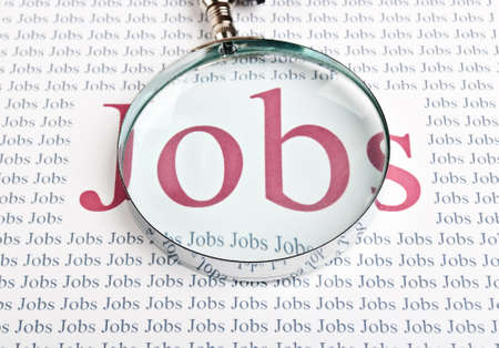 unemployment rate: job search with a magnifying glass background