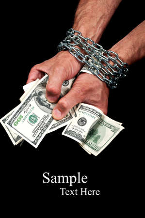Hands with dollars in chain on a black background Stock Photo - 10614570