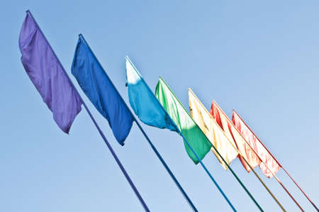 rainbow colored flags on blue sky background Stock Photo - 10614084