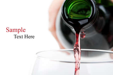 alcohol bottles: Man pouring red wine into a glass isolated on a white background