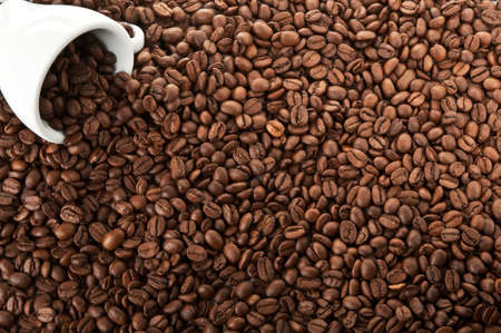 cup for espresso on coffee beans background