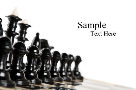 xadrez: black chess pieces isolated on a white background Banco de Imagens