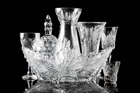 collection of crystal dishes isolated on a black background