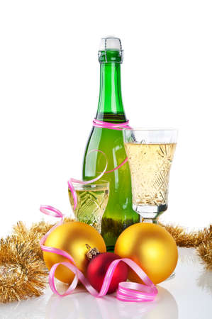 christmas balls and bottle of champagne isolated on a white background photo