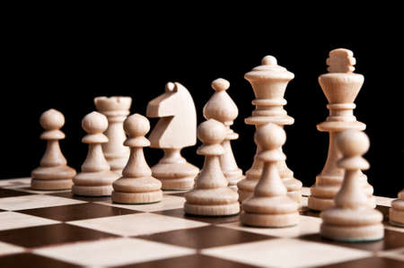 chess pieces isolated on a black background photo