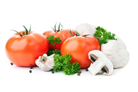 fresh red tomato and mushrooms isolated on a white background photo