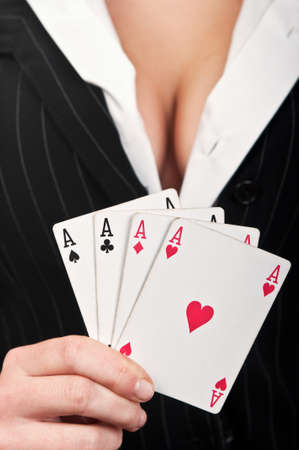 four poker aces on a breast woman background Stock Photo