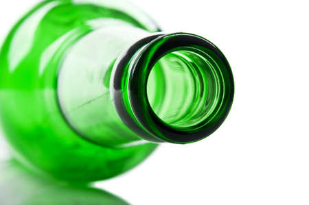 green and glass bottle isolated on a white background photo