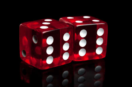 closeup of dice isolated on a black background photo