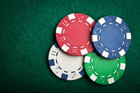 poker chips on green table background photo