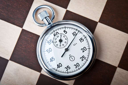 timescale: stopwatch and chessboard on a background