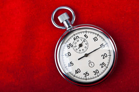 timescale: retro stopwatch on a red background Stock Photo