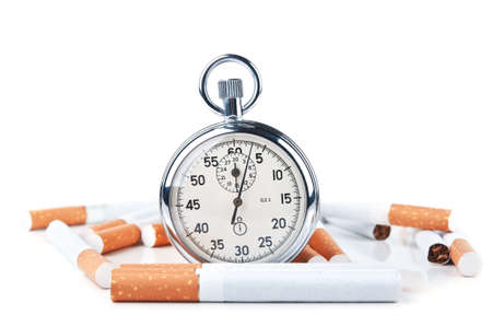 cigarettes and stopwatch isolated on a white background photo