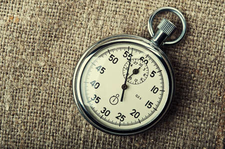 retro stopwatch on a fabric background photo