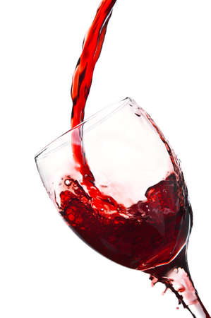 red wine pouring into wine glass isolated on a white background Stock Photo - 13507490