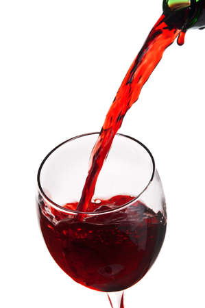 red wine pouring into wine glass isolated on a white background Archivio Fotografico