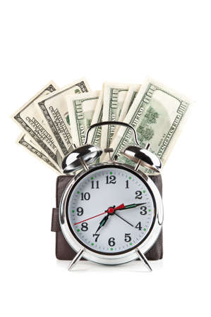 alarm clock and dollars isolated on a white background photo