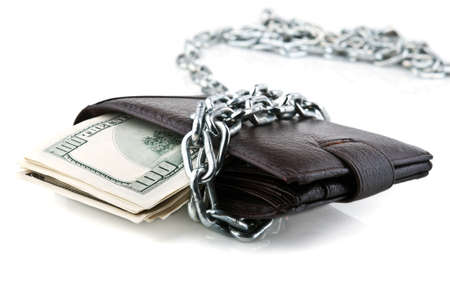 pile of dollars in chains isolated on a white background Stock Photo - 13507777