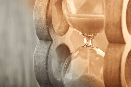 retro hourglass on wodden background