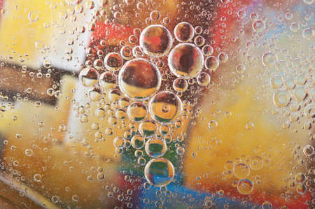 closeup of water bubbles on a color background photo