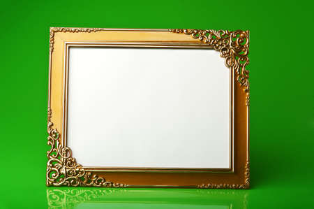 golden frame on green background photo