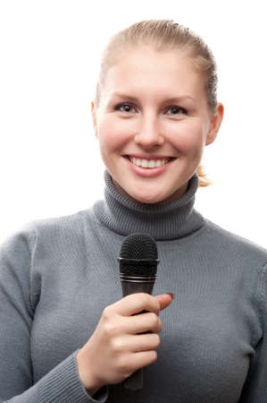 young girl holding microphone and smiling isolated on a white background photo