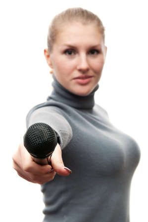 young woman holding a microphone isolated on a white background photo