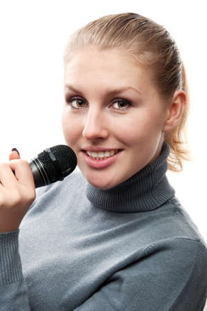 beautiful young woman singing into a microphone photo