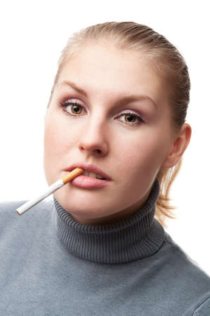young woman with a cigarette isolated on a white background photo