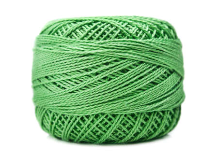 ball of green cotton yarn isolated on white background photo