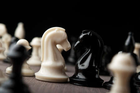 confrontation of chess knights on black background Stock Photo