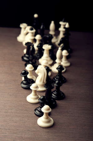 Set of chess pieces on table photo
