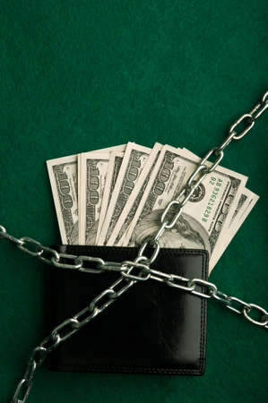 dollars bills and metal chain on background Stock Photo - 17334158