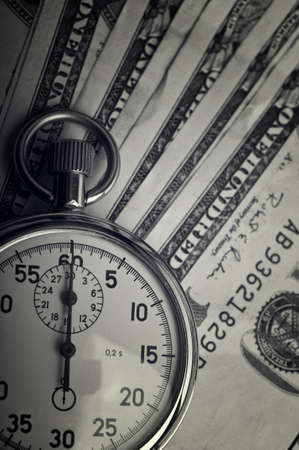dollars bills and stopwatch on background photo