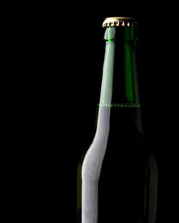 dewed: close up of bottle beer bubbles