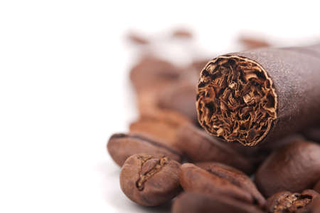 cigar and coffee beans isolated on white photo