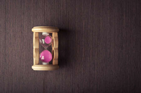 hourglass clock on wooden background Stock Photo - 17707158