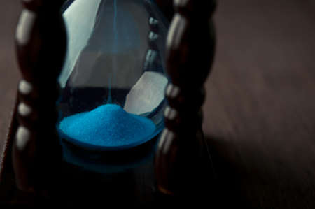 close up of hourglass clock photo
