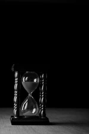 hourglass clock on black background photo