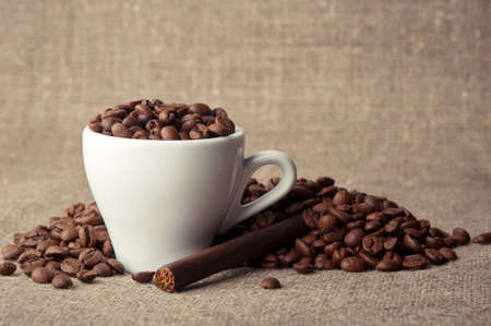 coffee cup with roasted beans background photo
